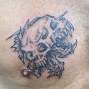 Three-Faced Skull Tattoo